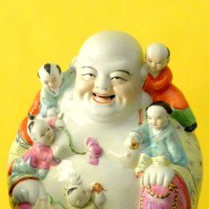 Budda cinese felice in ceramica